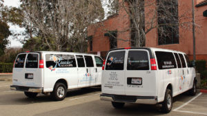 These two vans provide transportation for field trips and after school student pickups.