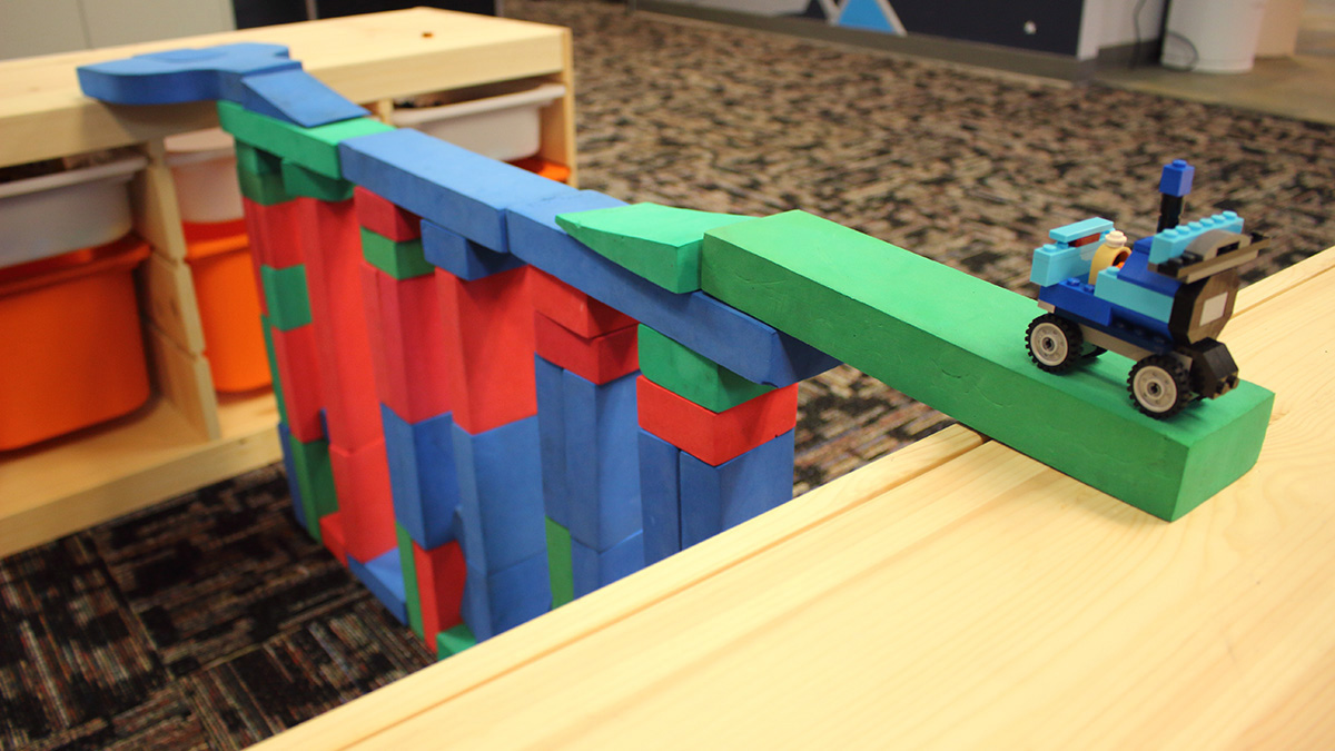 Our lounge area is filled with building blocks to teach principles of engineering.