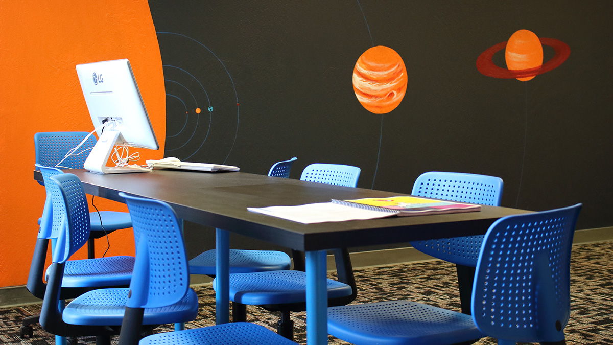 This classroom mural features all the planets of the solar system, painted in scale.