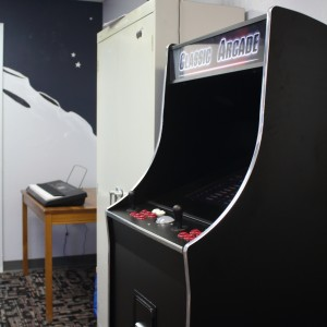 and our game machine loaded with hundreds of classic arcade games.