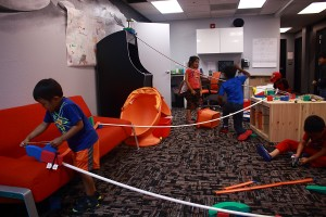Summer camp students learn about inputs, outputs and kinetic and potential energy, by working together to build a gigantic Rube Goldberg style marble machine.